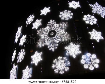 Christmas lights simulating frozen snowflakes. Barcelona street detail - stock photo