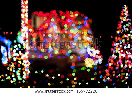 Christmas lights with house and Christmas tree as a background - stock photo