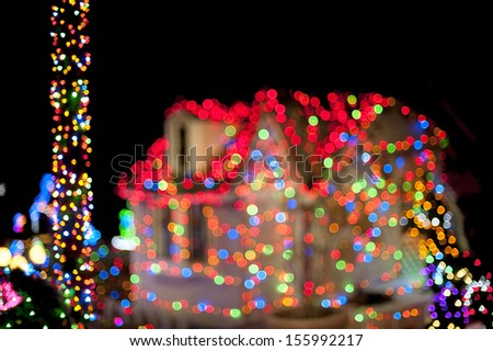 Christmas lights with house on the background