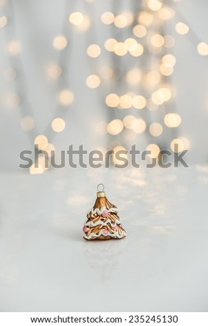 Christmas lights with ornaments. - stock photo