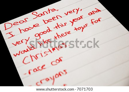Christmas list written by a child -on black background - stock photo