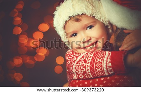 Christmas magic  a woman happy family mother and Child - stock photo