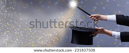 Christmas magic for copy space - magician hands with black hat and wand