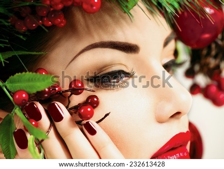 Christmas make up. Holiday New Year Makeup and manicure closeup. Beauty Woman face close up - stock photo