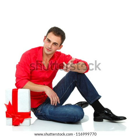 Christmas man with gift box, full length portrait of attractive holiday guy with present over white background