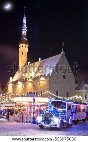 Christmas market and christmas train near city hall in old city of Tallinn, Estonia