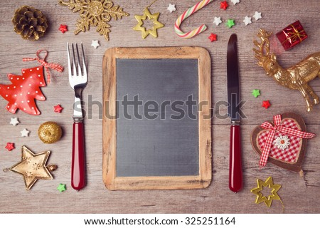 Christmas menu background with chalkboard and decorations. View from above - stock photo