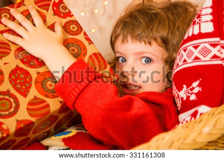 Christmas miracle, magic gift box and a child baby boy - stock photo