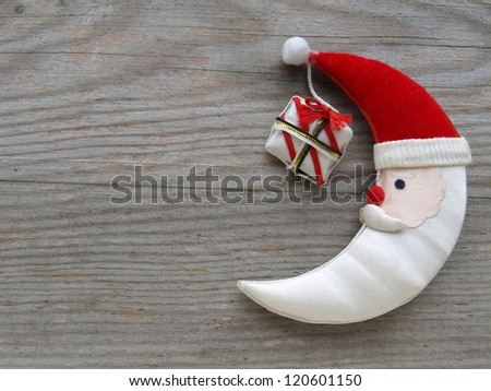 Christmas moon on a wooden board - stock photo