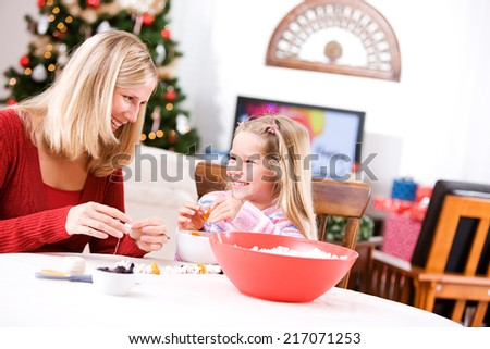Christmas: Mother And Child Making A Holiday Garland From Popcorn