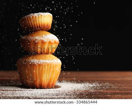 Christmas muffins covered powdered sugar, (background for congratulations) - stock photo
