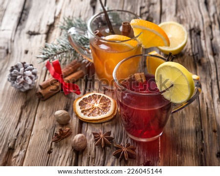 Christmas mull and punch on wooden table - stock photo