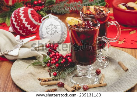 Christmas mulled wine. Delicious mulled wine with apple cider,  fruits and spices. A macro photograph with  shallow depth of field. Done with vintage retro filter. - stock photo