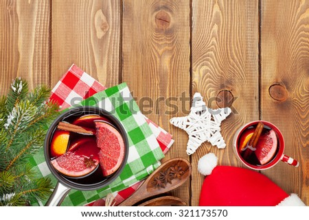 Christmas mulled wine on wooden table. View from above with copy space