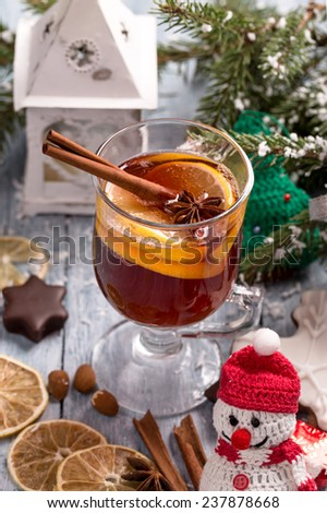 Christmas mulled wine with lemon slice, anise and cinnamon sticks and decorations - stock photo