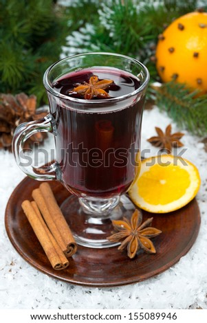 Christmas mulled wine with spices in glass, vertical, close-up