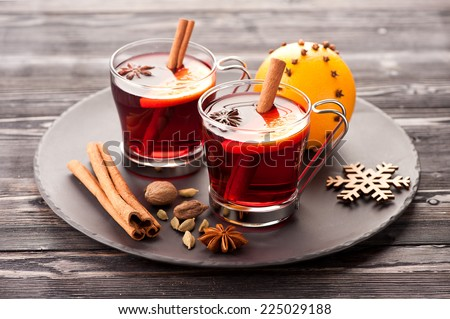 Christmas mulled wine with spices on wooden background - stock photo