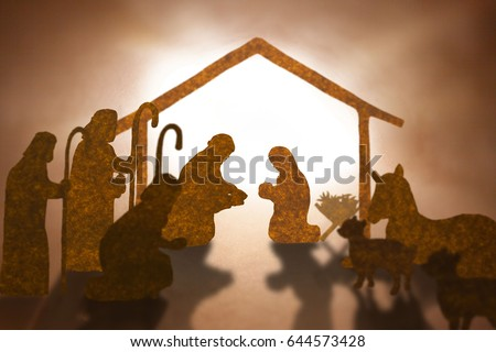 Christmas nativity scene including Jesus,Mary,Joseph,sheep and donkey ,Brown paper cut silhouette concept.