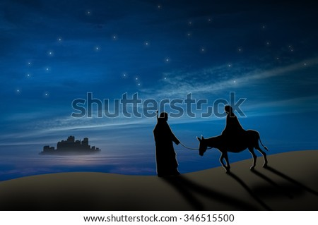 Christmas nativity scene of Joseph and Mary with donkey on the way to Bethlehem - stock photo