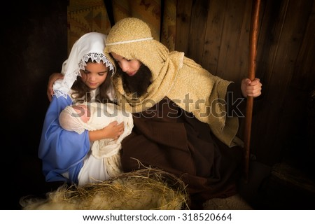 Christmas nativity scene reenacted by children and a doll - stock photo