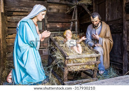 christmas nativity scene represented with statuettes of Mary, Joseph and baby Jesus - stock photo