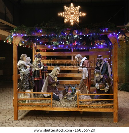 Christmas Nativity Scene with Three Wise Men Presenting Gifts to Baby Jesus, Mary & Joseph - stock photo