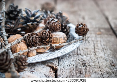 Christmas Natural Decoration on Tray with Small Pine cones, Walnuts, Almonds. Horizontal - stock photo