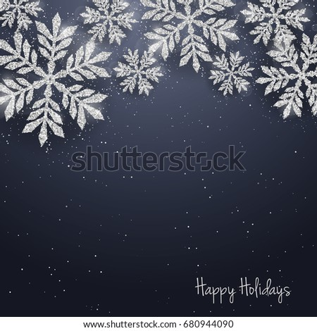 Christmas New Year greeting card with sparkling glitter silver textured snowflakes. Seasonal holidays background