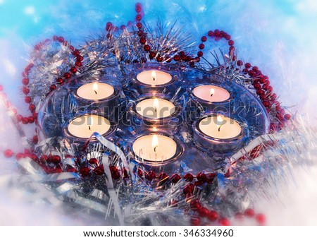 Christmas, New Year, holiday candles, candle holder, Christmas toys on a blue background. Photo in old image style, vintage, retro - stock photo