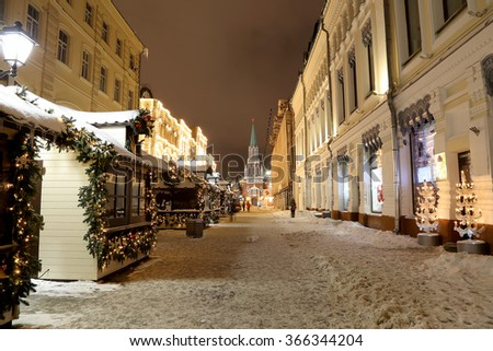 Christmas (New Year holidays) illumination on Nikolskaya Street near the Moscow Kremlin at night, Russia    - stock photo