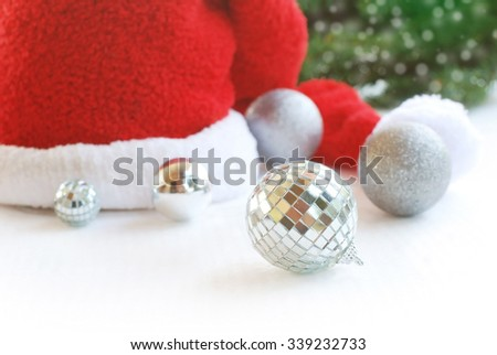 Christmas, New Year silver ball  and Santa hat on white background