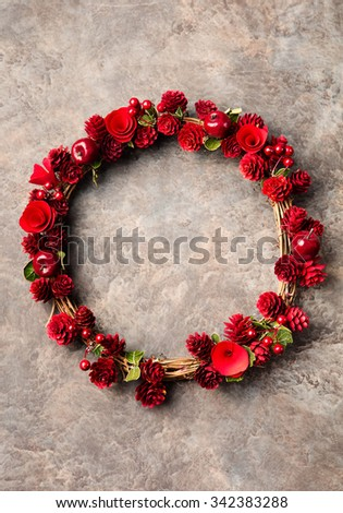 Christmas, New Year wreath with apples, cones and flowers on a dark stone background Copy space - stock photo