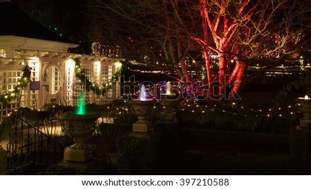 Christmas night in Butchart Gardens, Victoria, BC, Canada - December 5, 2011: Butchart gardens decorated for Holiday season. The garden is one of major attractions in the city of Victoria, BC, Canada. - stock photo