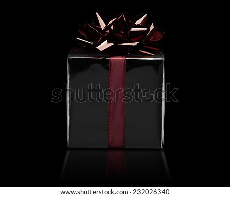 christmas or birthday gift wrapped with red bow - stock photo