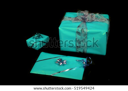 christmas or birthday presents on the black background