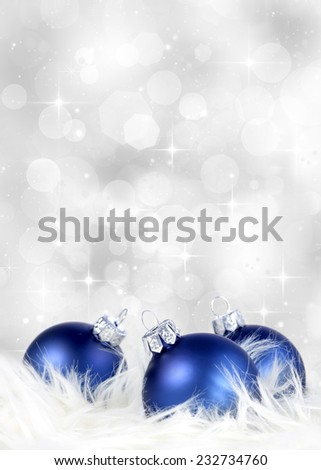 Christmas or holiday background with blue silver ornaments on billowy feathers - stock photo