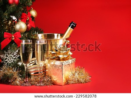Christmas or New Year's Eve. Champagne and Presents over Red Background. Celebration - stock photo