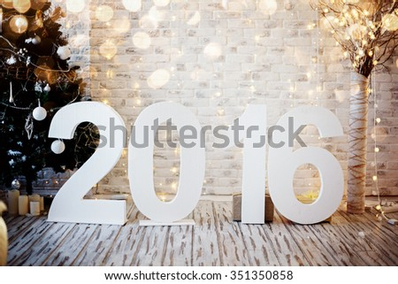 Christmas or New Year's interior. Big figures 2016. Holidays decor. - stock photo