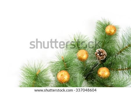 Christmas orange  ball and fir tree on white background. - stock photo