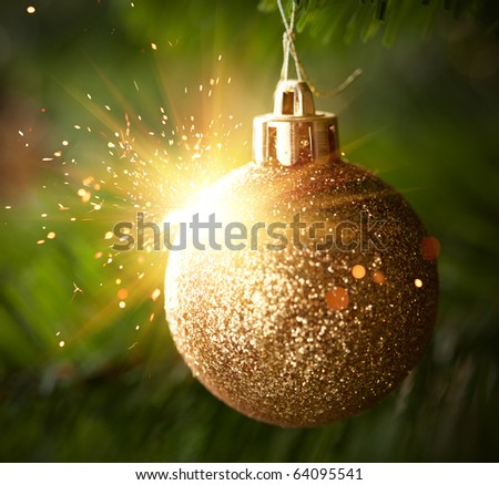 Christmas ornament ball with shiny sparks - stock photo