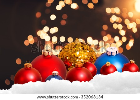 christmas ornament in snow on bokeh background
