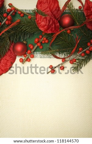 Christmas ornament made of green spruce and red adornment - stock photo