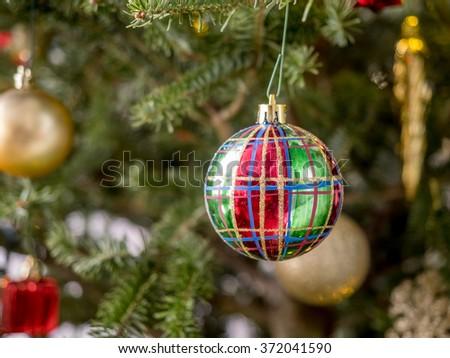 Christmas ornament on Christmas tree. - stock photo