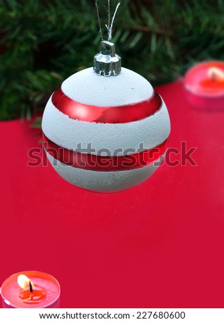 Christmas ornament on red  - stock photo