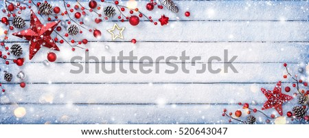 Christmas Ornament On Wooden Background With Snowflakes