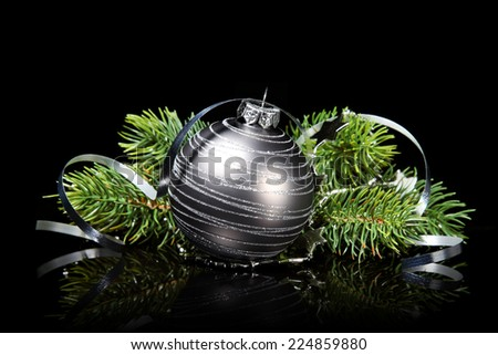 Christmas ornament with fir on a black background  - stock photo