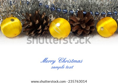 Christmas ornaments and pine cones - copy space for text - stock photo