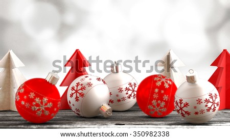 Christmas ornaments, balls, paper trees on a wooden table in front of bokeh background. Copy space available.