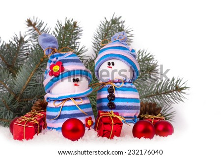 Christmas ornaments cheerful snowmen on Christmas tree isolated. Christmas border with ornament, present and snow - stock photo
