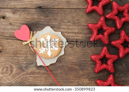Christmas ornaments - glittering star and Christmas cookies on rustic wooden background - copy space